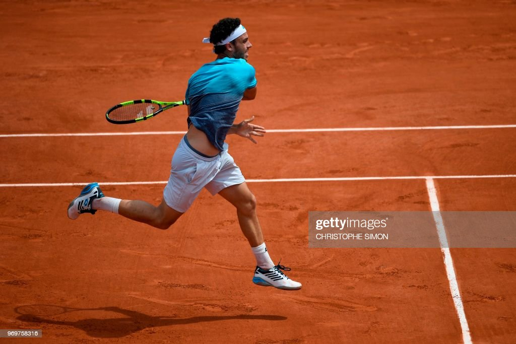 Italy's Marco Cecchinato plays a forehand return to Austria's Dominic Thiem during their men's singles semi-final match on day thirteen of The Roland Garros 2018 French Open tennis tournament in Paris on June 8, 2018.