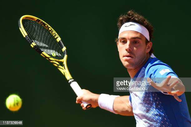 Italy's Marco Cecchinato plays a forehand return to Bosnia Herzegovina's Damir Dzumhur during their tennis match on the day 3 of the Monte-Carlo ATP...