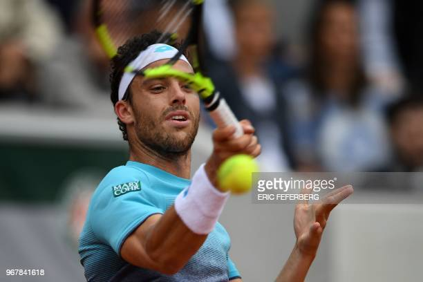 TOPSHOT Italy's Marco Cecchinato plays a forehand return to Serbia's Novak Djokovic during their men's singles quarterfinal match on day ten of The...