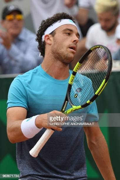 Italy's Marco Cecchinato reacts after a point against Argentina's Marco Trungelliti during their men's singles second round match on day four of The...