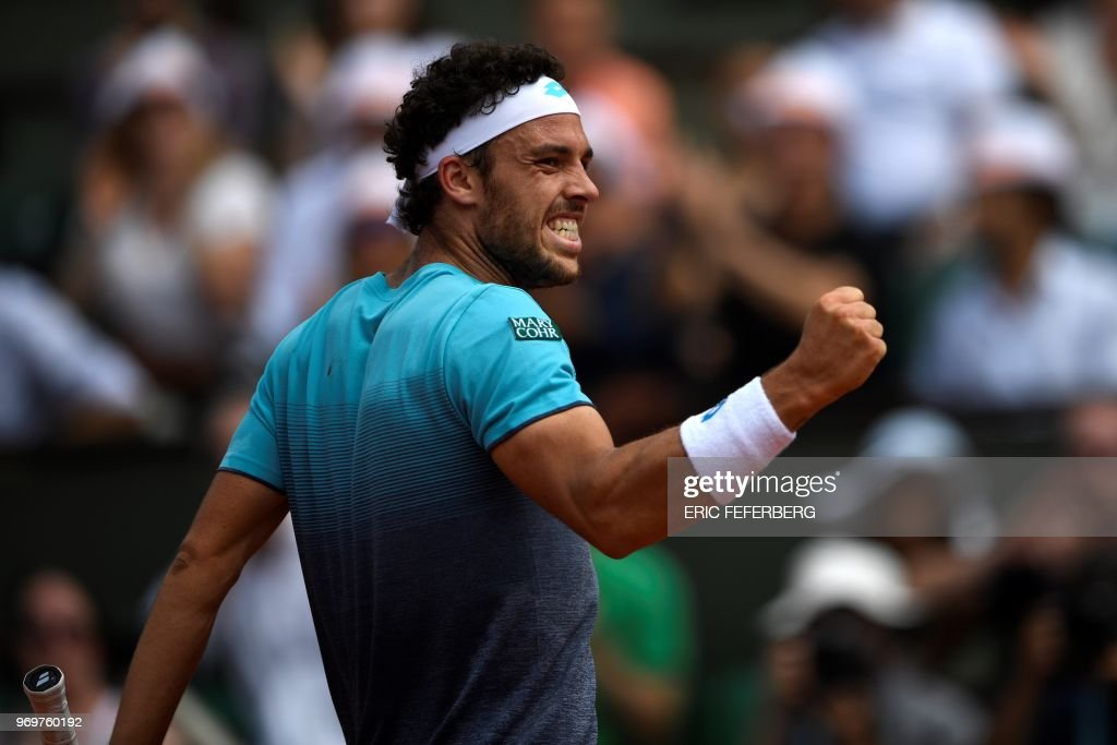 Italy's Marco Cecchinato reacts after a point against Austria's Dominic Thiem during their men's singles semi-final match on day thirteen of The Roland Garros 2018 French Open tennis tournament in Paris on June 8, 2018.