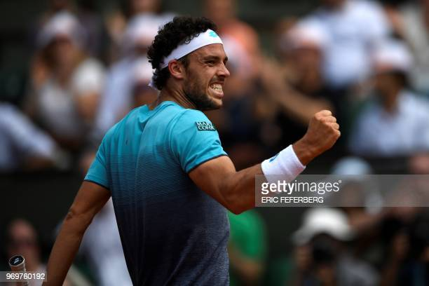 Italy's Marco Cecchinato reacts after a point against Austria's Dominic Thiem during their men's singles semifinal match on day thirteen of The...