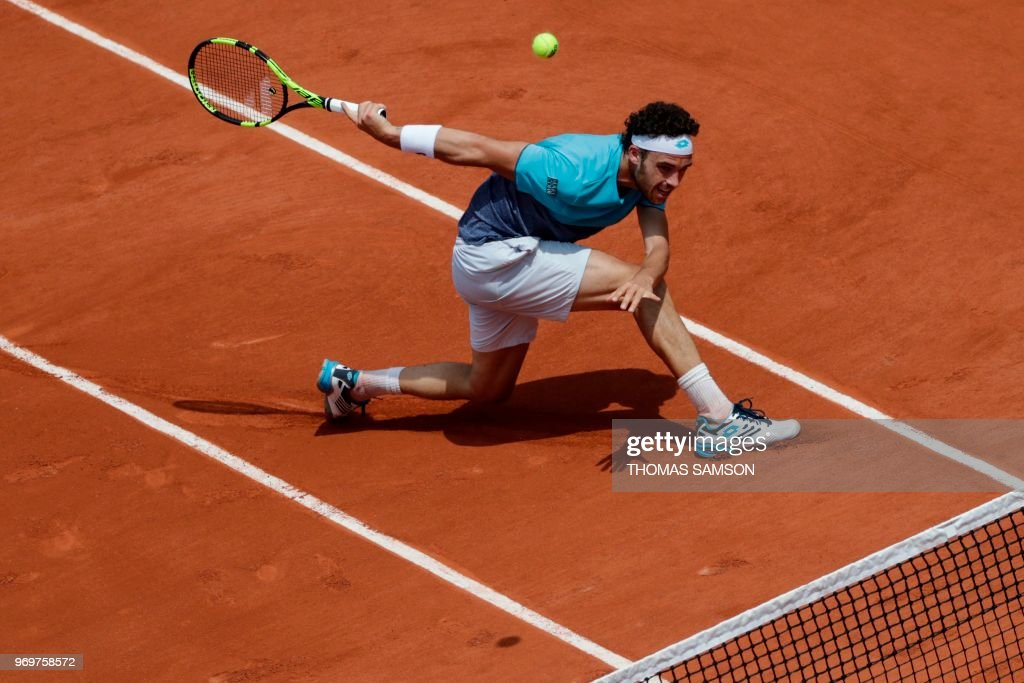 Italy's Marco Cecchinato returns the ball to Austria's Dominic Thiem during their men's singles semi-final match on day thirteen of The Roland Garros 2018 French Open tennis tournament in Paris on June 8, 2018.