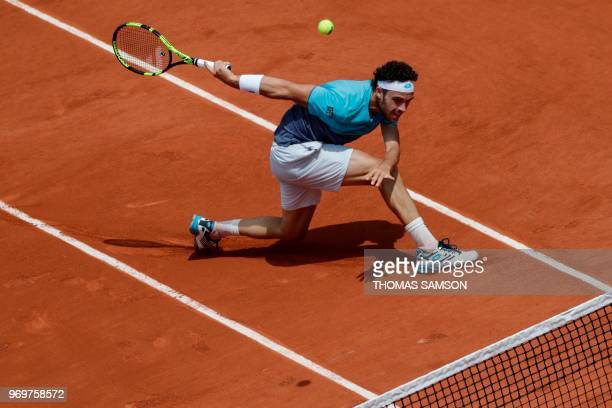 Italy's Marco Cecchinato returns the ball to Austria's Dominic Thiem during their men's singles semifinal match on day thirteen of The Roland Garros...