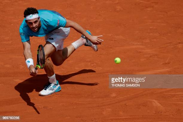 Italy's Marco Cecchinato returns the ball to Austria's Dominic Thiem during their men's singles semi-final match on day thirteen of The Roland Garros...
