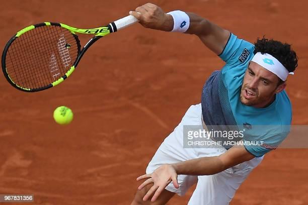 Italy's Marco Cecchinato serves to Serbia's Novak Djokovic during their men's singles quarterfinal match on day ten of The Roland Garros 2018 French...