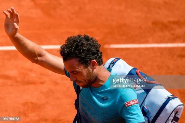 Italy's Marco Cecchinato waves as he leaves the court after defeat by Austria's Dominic Thiem in their men's singles semifinal match on day thirteen...