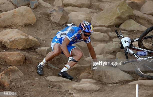 Italy's Marco Fontana falls down during the Men's Cross Country Elite Championships at the Cascades Mountain Bike Track in Pietermaritzburg South...