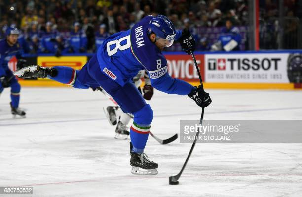 Italy´s Marco Insam plays the puck during the IIHF Ice Hockey World Championships first round match between Italy and Latvia in Cologne western...