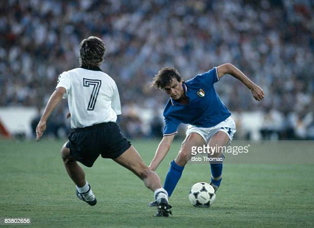 Italy's Marco Tardelli is faced by West Germany's Pierre Littbarski during the World Cup Final at the Estadio Bernabeu in Madrid 11th July 1982 Italy...