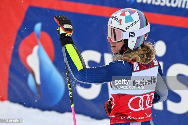 Italy's Marta Bassino celebrates in the finishing area after competing in the second run of the Women's Giant Slalom event during the FIS Alpine ski...
