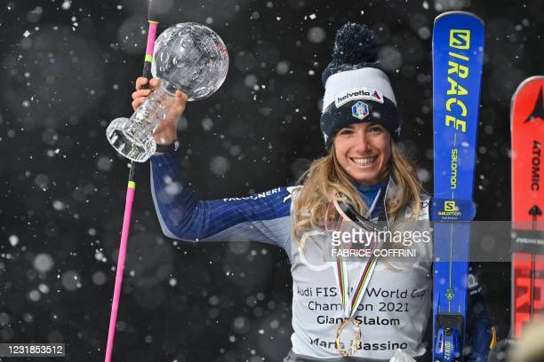 Italy's Marta Bassino poses for pictures with the Overall Cristal Globe of the FIS Alpine Ski World Cup for the Women's Giant Slalom during the...