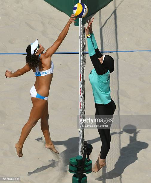 Italy's Marta Menegatti jumps for the ball during the women's beach volleyball qualifying match between Italy and Egypt at the Beach Volley Arena in...