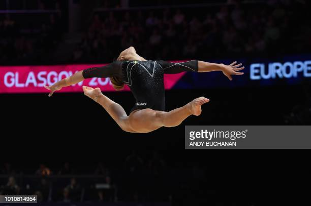 Italy's Martina Basile competes in the women's team final of the artistic gymnastics at the SSE Hydro during the 2018 European Championships in...