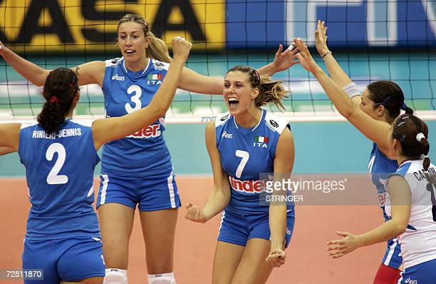 Italy's Martina Guiggi celebrates with teammates after scoring a point against Japan during their second round Pool E match at the Women's Volleyball...