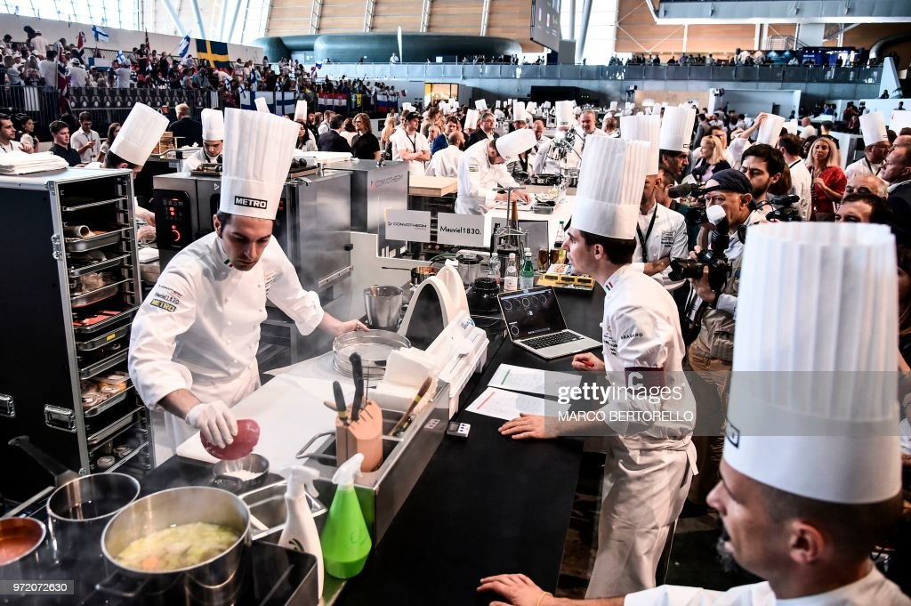 Italy's Martino Ruggieri (L) competes during the event of the Bocuse d'Or Europe 2018 International culinary competition, on June 12, 2018 in Turin.
