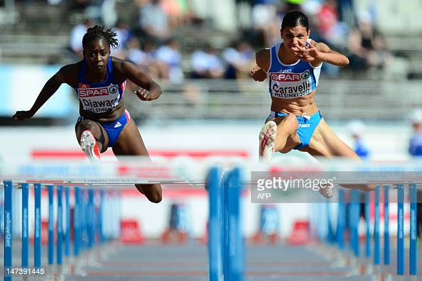 Italy's Marzia Caravelli and France's Aisseta Diawara compete in the women's 100m hurdles qualifications at the 2012 European Athletics Championships...