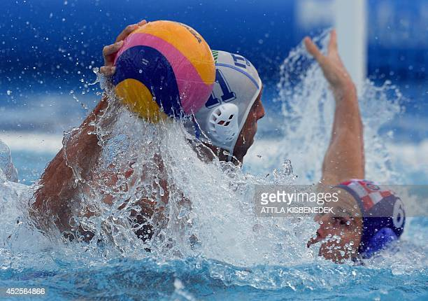 Italy's Matteo Aicardi fights for the ball with Croatia's Ivan Buljubasic during the men's Water Polo European Championships quarter final match of...
