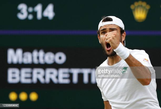 Italy's Matteo Berrettini celebrates a point against Poland's Hubert Hurkacz during their men's singles semi-final match on the eleventh day of the...