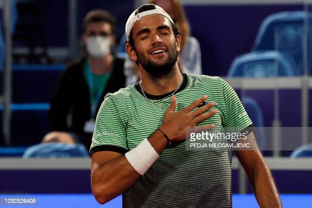 Italy's Matteo Berrettini celebrates after winning against Russia's Aslan Karatsev in their ATP 250 Serbia Open final singles tennis match at The...