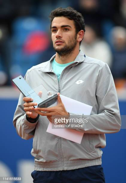 Italy's Matteo Berrettini holds the second place trophy during the winner ceremony after the final match against Chile's Christian Garin at the ATP...