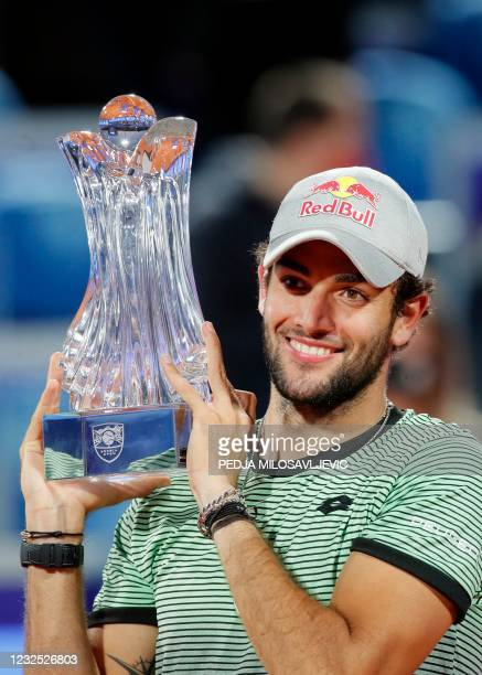 Italy's Matteo Berrettini holds up the trophy after defeating Russia's Aslan Karatsev in their ATP 250 Serbia Open final singles tennis match at The...