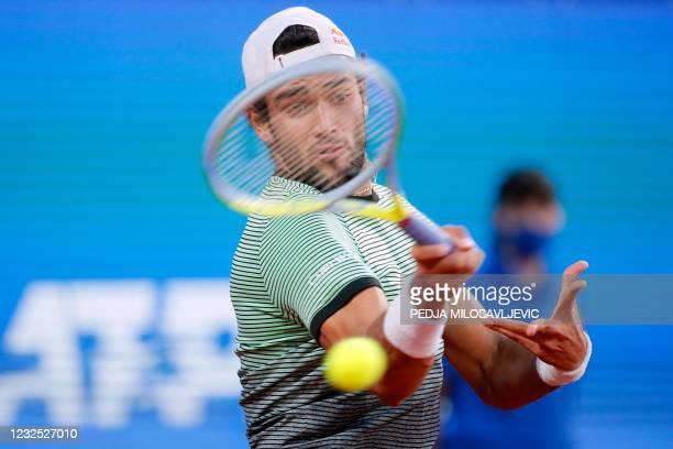 Italy's Matteo Berrettini plays a forehand return to Russia's Aslan Karatsev during their ATP 250 Serbia Open final singles tennis match at The Novak...