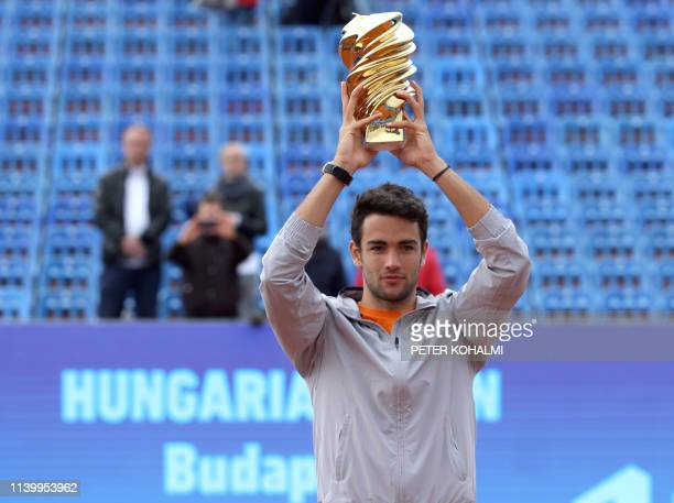 Italy's Matteo Berrettini poses with the trophy after his victory over Serbia's Filip Krajinovic during the ATP final tennis match at the Hungarian...