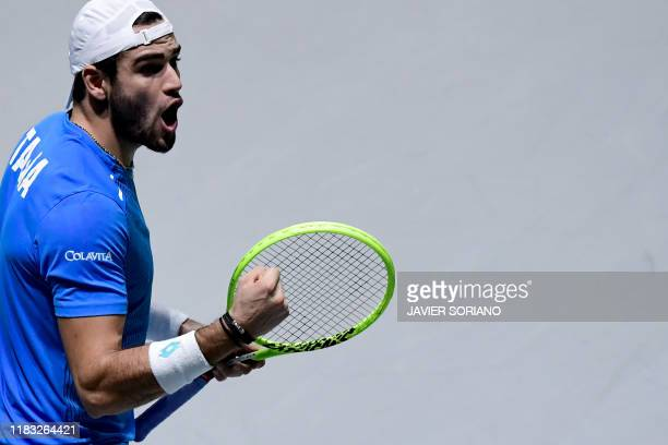 Italy's Matteo Berrettini reacts during his singles tennis match against Canada's Denis Shapovalov at the Davis Cup Madrid Finals 2019 in Madrid on...