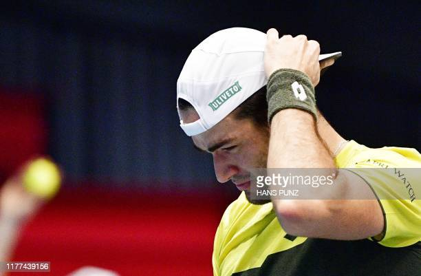 Italy's Matteo Berrettini reacts during the match against Great Britain's Kyle Edmund at the ATP Open Tennis tournament in Vienna, Austria, on...