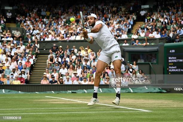 Italy's Matteo Berrettini returns against Poland's Hubert Hurkacz during their men's singles semi-final match on the eleventh day of the 2021...