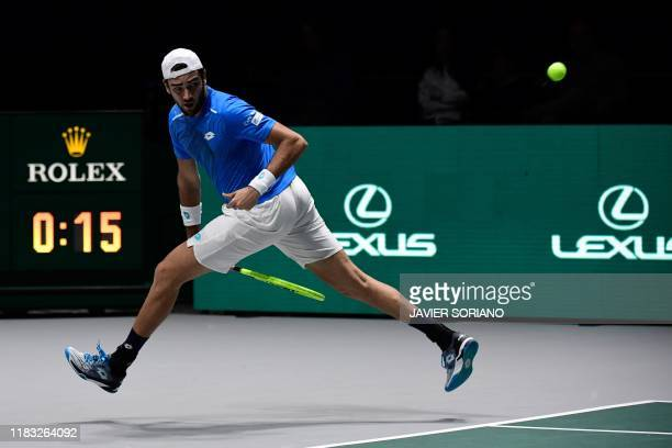 Italy's Matteo Berrettini returns the ball to Canada's Denis Shapovalov during the singles tennis match between Italy and Canada at the Davis Cup...