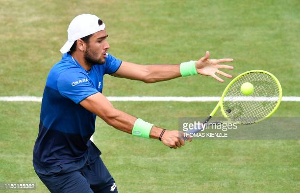 Italy's Matteo Berrettini returns the ball to Germany's Jan-Lennard Struff in their semifinal match at the ATP Mercedes Cup tennis tournament in...
