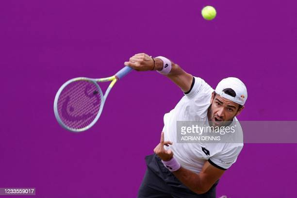 Italy's Matteo Berrettini serves to Britain's Cameron Norrie during their men's singles final tennis match at the ATP Championships tournament at...