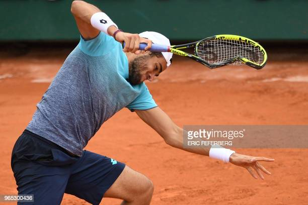Italy's Matteo Berrettini smashes his racquet into the court after a point against Austria's Dominic Thiem during their men's singles third round...