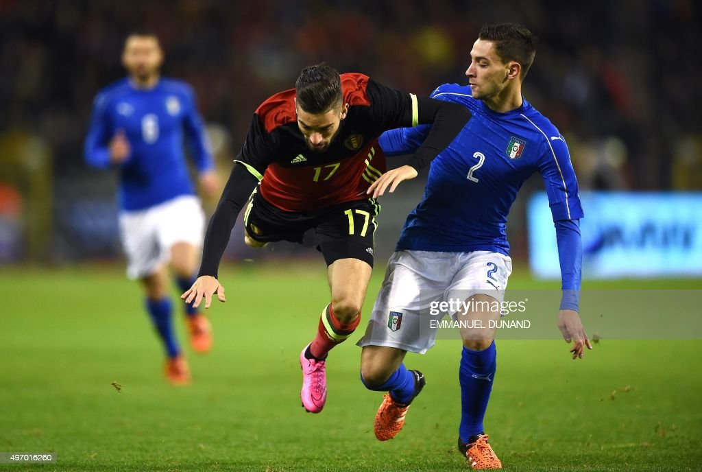 Italy's Mattia De Sciglio (R) and Belgium's Yannick Carrasco vie for the ball during the friendly international match between Belgium and Italy at Baudoin King Stadium in Brussels, on November 13, 2015. AFP PHOTO/Emmanuel Dunand