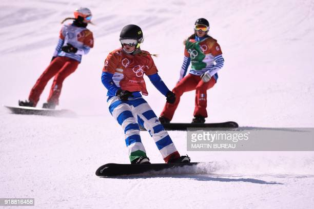 Italy's Michela Moioli finishes ahead of France's Julia Pereira De Sousa Mabileau and France's Chloe Trespeuch during the women's snowboard cross...