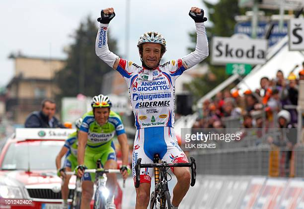 Italy's Michele Scarponi crosses the finish line of stage 19 of the 93rd Giro of Italia from Brescia to Aprica on May 28 2010 Former Giro winner Ivan...