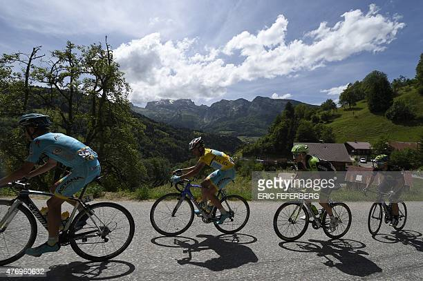 Italy's Michele Scarponi Italy's Vincenzo Nibali wearing the overall leader's yellow jersey USA's Andrew Talansky and Spain's Alejandro Valverde...