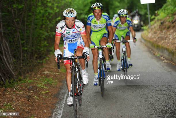 Italy's Michele Scarponi Ivan Basso and teammate Vincenzo Nibalia cycle up the Mortirolo pass during stage 19 of the 93rd giro of Italy from Brescia...