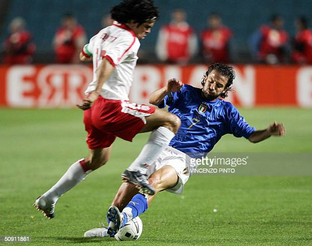 Italy's midfielder Alessandro Del Piero tackles Tunisian Chedli Adel during their friendly football match at Rades stadium in Tunis 30 May 2004. AFP...