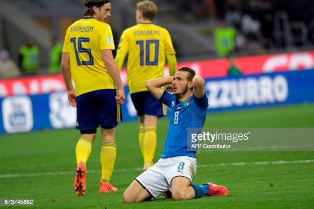 TOPSHOT Italy's midfielder Alessandro Florenzi reacts during the FIFA World Cup 2018 qualification football match between Italy and Sweden on...