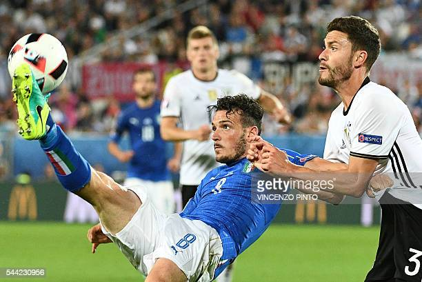 Italy's midfielder Alessandro Florenzi vies for the ball against Germany's defender Jonas Hector during the Euro 2016 quarterfinal football match...