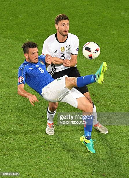 Italy's midfielder Alessandro Florenzi vies for the ball with Germany's defender Jonas Hector during the Euro 2016 quarterfinal football match...