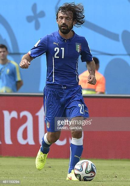 Italy's midfielder Andrea Pirlo drives the ball during a Group D football match between Italy and Uruguay at the Dunas Arena in Natal during the 2014...