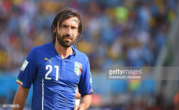 Italy's midfielder Andrea Pirlo reacts during the Group D football match between Italy and Uruguay at the Dunas Arena in Natal during the 2014 FIFA...
