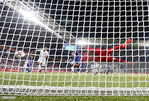 Italy's midfielder Antonio Candreva scores a goal during their World Cup 2018 qualification match between Israel and Italy at the Sammy Ofer Stadium...
