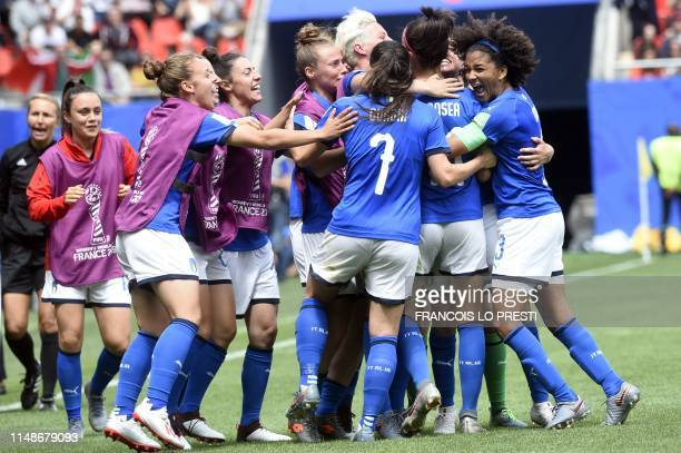 Italy's midfielder Barbara Bonansea is congratulated by teammates after scoring a goal celebrates after scoring a goal during the France 2019 Women's...