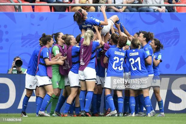 Italy's midfielder Barbara Bonansea is congratulated by teammates after scoring her second goal during the France 2019 Women's World Cup Group C...