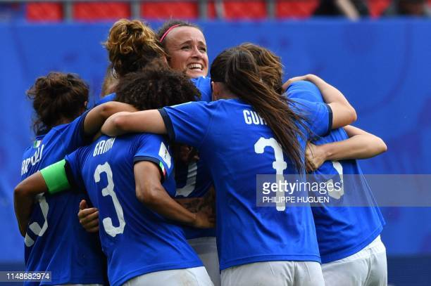 Italy's midfielder Barbara Bonansea is congratulated by teammates after scoring the decisive goal during the France 2019 Women's World Cup Group C...